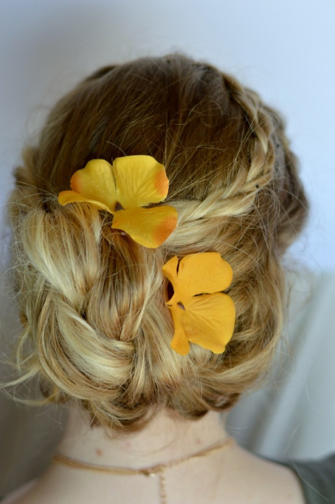 Easy and beautiful boho braided updo! Add silk flowers to the side of the bun to give it a springtime vibe // www.heytherechelsie.com