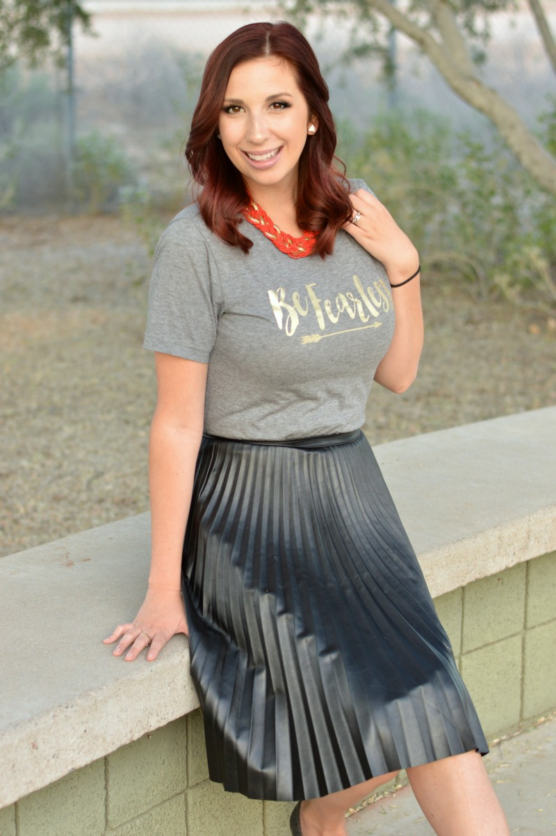 How to Style a Graphic Tee: Add a pleated circle skirt and statement necklace to jazz it up! Love this graphic tee outfit // www.heytherechelsie.com