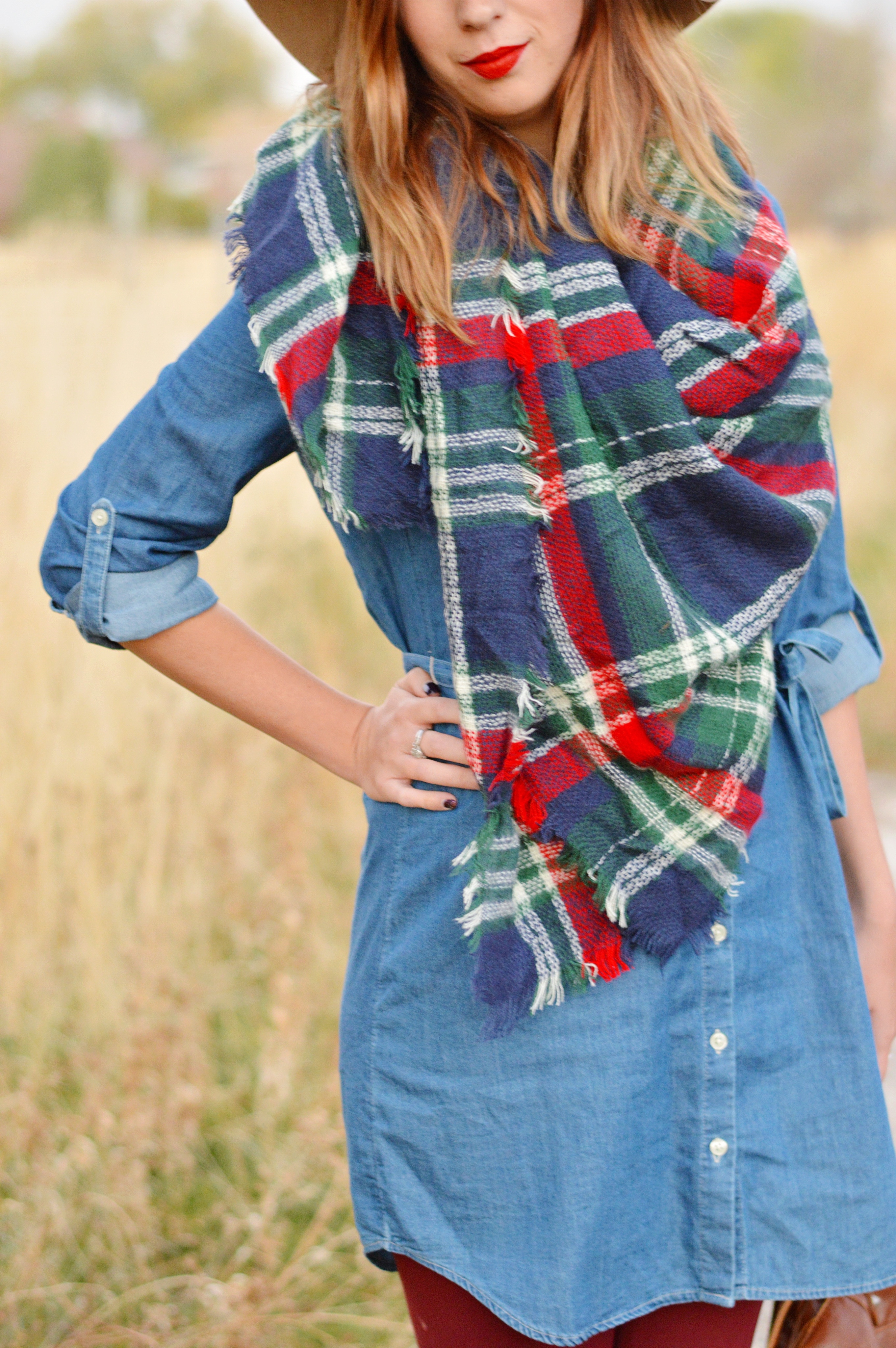 15+ Affordable Fall Outfits to Wear // Sharing my secret to building my Fall 2016 wardrobe on a budget while staying on top of trends. This chambray shirt dress, blanket scarf, booties and floppy hat combo is a great fall outfit and cost me under 40 dollars to put together. Get the details on this outfit and 15 more fall outfit ideas here