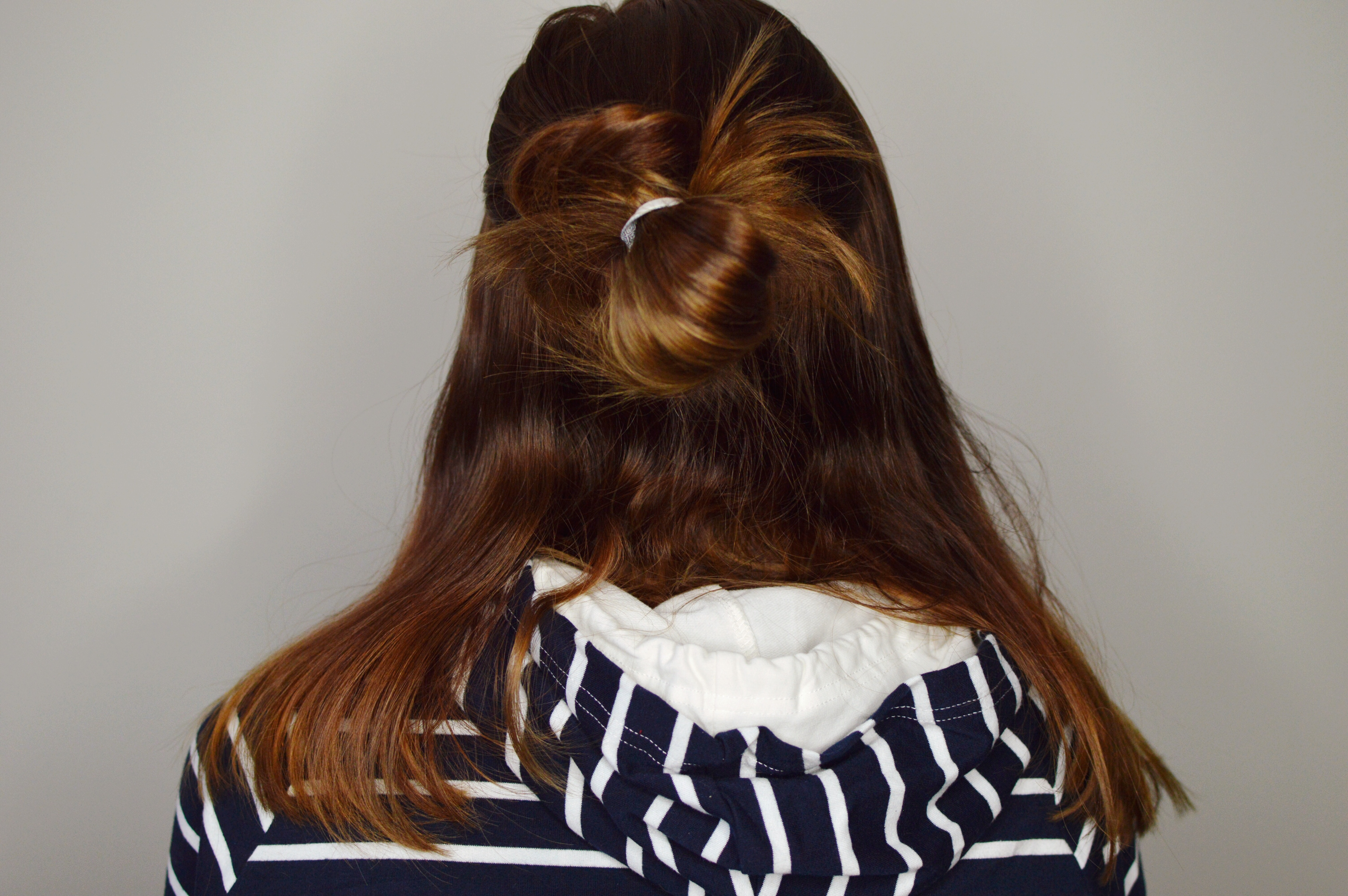 Easy tutorial on how to complete a double messy bun - a more sophisticated and fancy version of the regular double bun! // Hey There, Chelsie